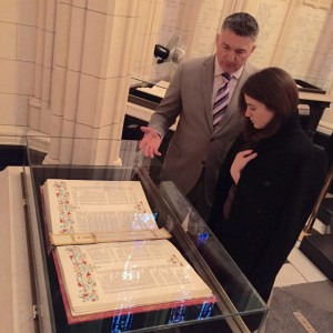 Yulia looks at a World War II-era Book of the Dead.